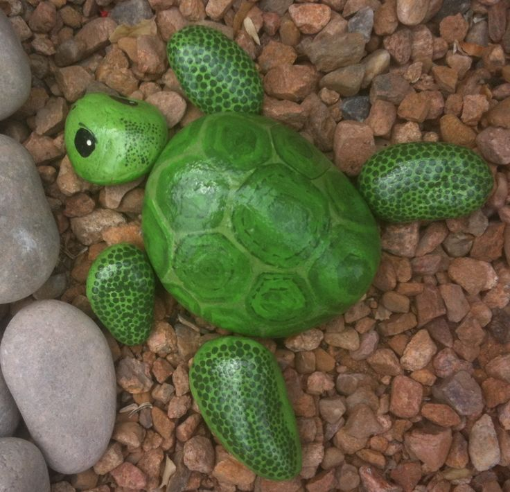Turtle painted on river rocks. I made this to sit next to my painted faux koi pond.