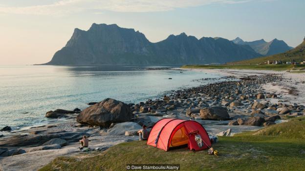 camping on beautiful Uttakleiv Beach in the Lofoten Islands, Norway