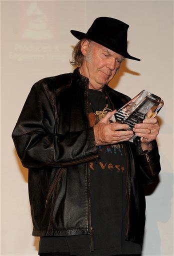 Neil Young accepts his tribute award at the Producers and Engineers of the Academy's 7th Annual Grammy Week Event, at the Village Studios on Jan.  <div id=