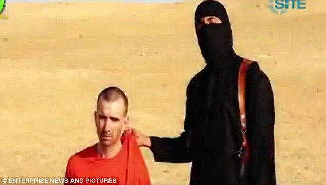 US spy planes are flying over British skies in hunt for Jihadi John's associates as net closes in on London suburb
