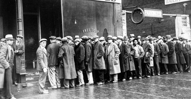 The Great Depression. Unemployed men queued outside a soup kitchen opened in Chicago by Al Capone. The storefront sign reads 'Free Soup, Coffee and Doughnuts for the Unemployed.' Chicago, 1930s (Newscom TagID: evhistorypix027753.jpg) [Photo via Newscom]