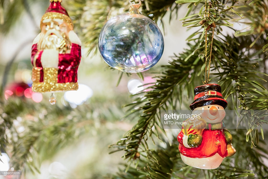 Christmas baubles and Santa Claus hanging on Christmas tree, Munich, Germany : Stock Photo