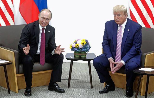 OSAKA, JAPAN - JUNE 28, 2019: Russia's President Vladimir Putin (L) and US President Donald Trump during a meeting on the sidelines of the 2019 G20 Summit at the INTEX Osaka International Exhibition Centre. Mikhail Metzel/TASS ßïîíèÿ. Îñàêà. Ïðåçèäåíò Ðîññèè Âëàäèìèð Ïóòèí è ïðåçèäåíò ÑØÀ Äîíàëüä Òðàìï (ñëåâà íàïðàâî) âî âðåìÿ âñòðå÷è â ðàìêàõ 14-ãî ñàììèòà ëèäåðîâ ñòðàí Ãðóïïû äâàäöàòè (G20) â ìåæäóíàðîäíîì âûñòàâî÷íîì êîìïëåêñå INTEX Osaka. Ìèõàèë Ìåòöåëü/ÒÀÑÑ