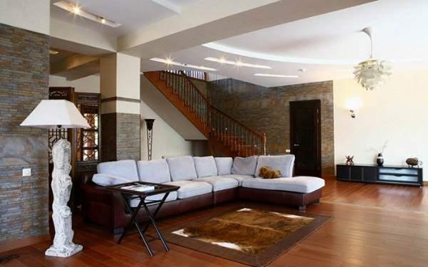 Интерьер гостиной с лестницей в частном доме - фото красивого дизайна