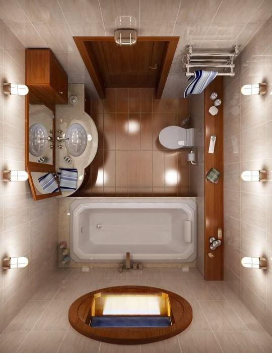 Сочетание светлого и коричневого оттенка керамической плитки в отделке ванной комнаты.