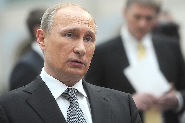 Путин приехал на митинг-концерт на Манежной площади в Москве