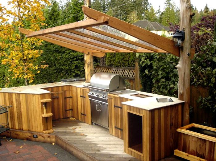 Угловая кухня с навесом. | Фото: The Architecture Home.