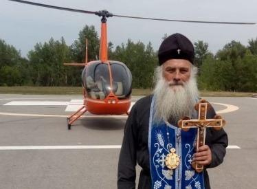 На Алтае чиновники попросили митрополита облететь с иконами леса, чтобы не горели