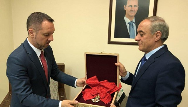 Асад вернул Парижу Французский орден почетного легиона