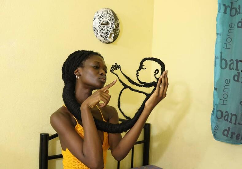 Фото: девушка сделала себе из волос грудь, велосипед и ребенка волосы,интересное,красота,прически