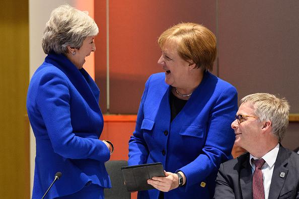 Тереза Мэй и Ангела Меркель в одинаковых костюмах