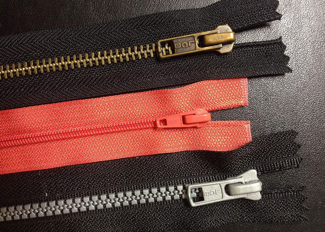 Zippers with common teeth variations: metal teeth (top), coil teeth and plastic teeth