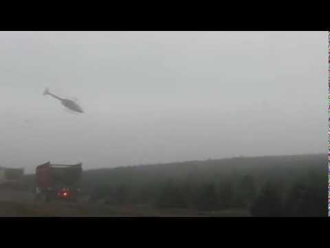 Вертолет грузит елки на Рождество, 80LVL(strangeworlds.at.ua)