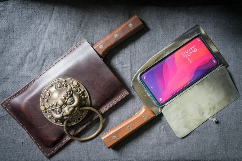 Cellphone cases designed to look like meat cleavers are Geng Shuai's hottest product. He's sold 10. (Yan Cong / The Washington Post)