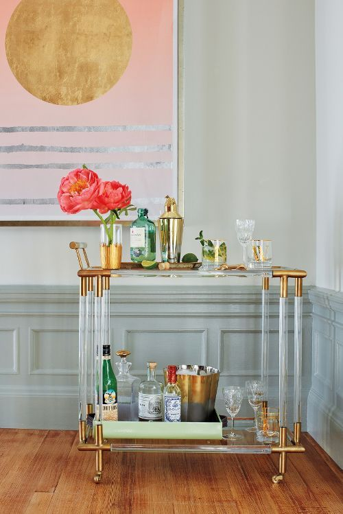 27 lucite bar cart with gilded elements looks super elegant