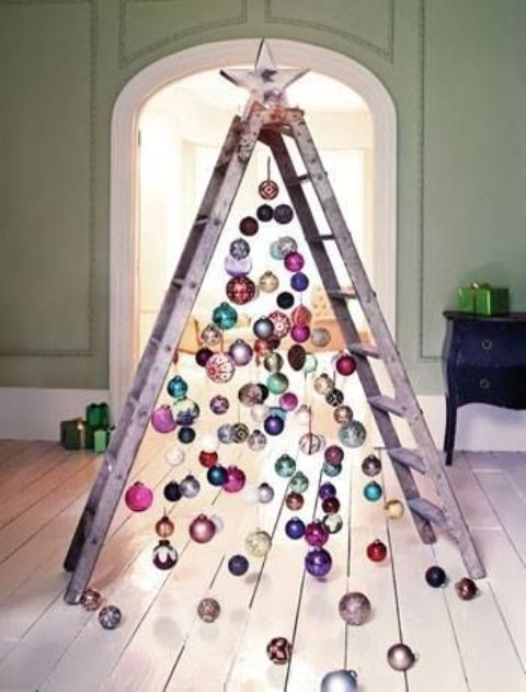 25 a chic ladder christmas tree with colorful ornaments all over and on the floor for a messy and relaxed touch