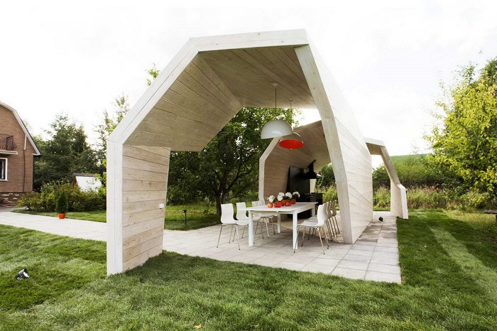 Беседка для дачного участка необычной формы в стиле модерн.