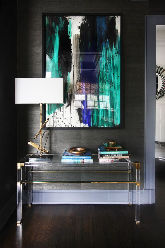24 lucite and brass console table with a storage space looks almost invisible