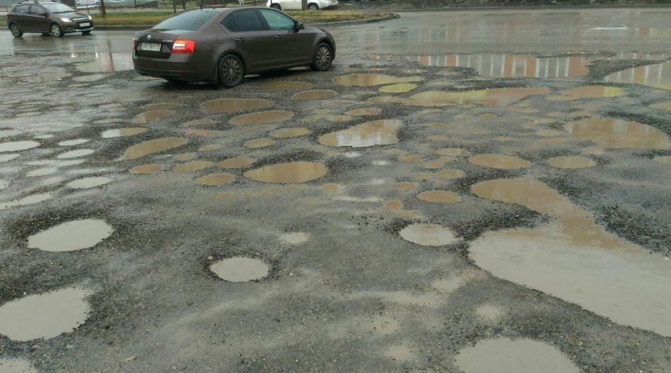 Отремонтированная в Краснодаре дорога покрылась ямами спустя две недели авто и мото