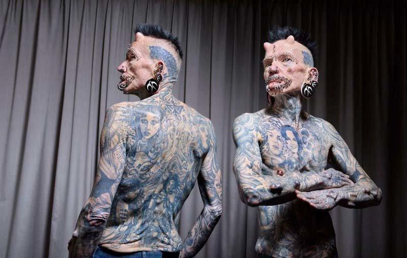 59-летний немец Рольф Буххольц имеет на своём теле 516 татуировок, пирсинг и имплантаты в мире, гиннесс, животные, люди, рекорд, факты