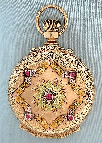 Beautiful Howard multicolor 14K gold and stone set box hinge antique pocket watch circa 1883. The engraved case with elaborate stone set designs in various colors of gold. White enamel dial with blued steel hands (hour hand replaced). Damascened 15 jewel adjusted nickel movement with screwed jewel settings and precision regulator. Handsome example.: