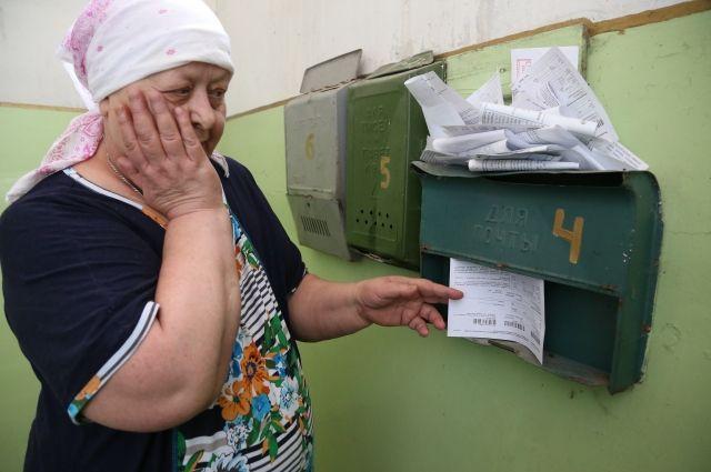 Загляни без страха в платёжку. Кто поможет россиянам осилить долги за ЖКХ?