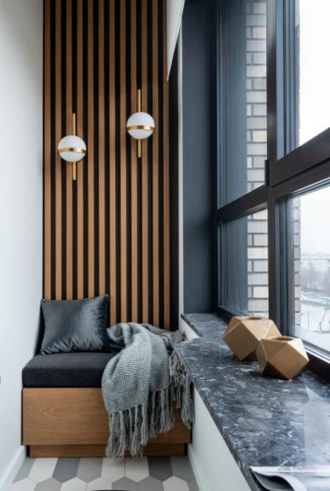 Стена, украшенная деревянными рейками.   Фото: Houzz.