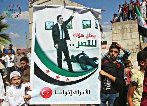 Убийца Карлова на демонстрации джихадистов