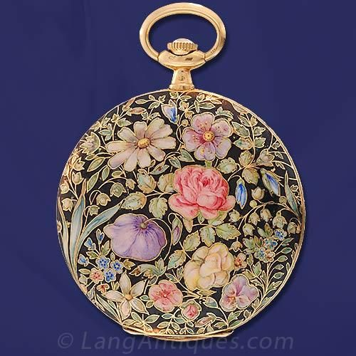 An extraordinary floral enameled hunter case pocket watch with Longines case, J. Schultz 17 Jewel movement, circa 1900, featuring a gorgeous enameled case with black background and a multi-color floral design: