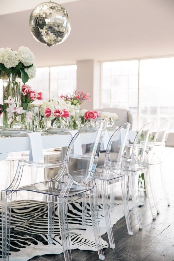 08 acrylic dining chairs and an animal print rug for a glam dining space