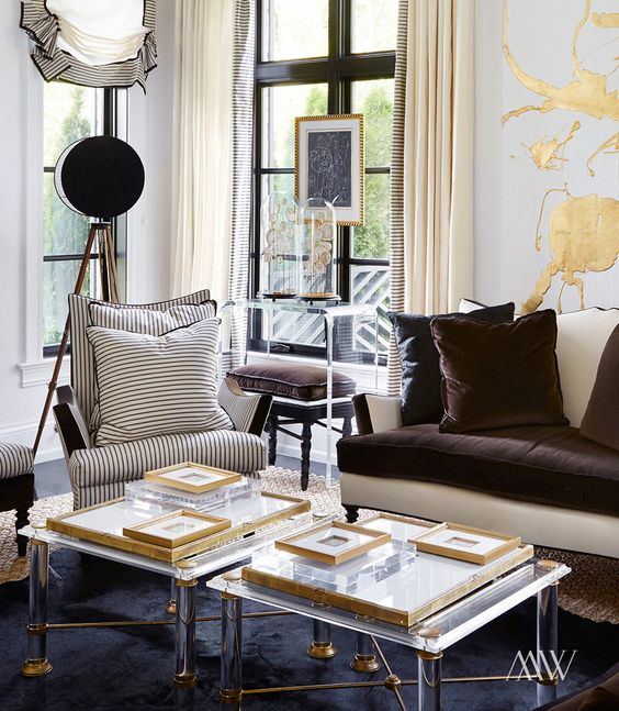 19 duo of lucite coffee tables with brass details make the living room exquisite