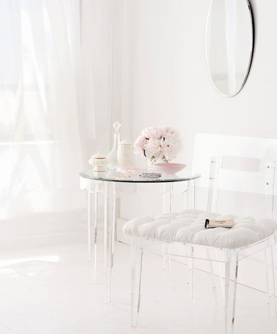 13 a lucite chair with a white upholstered seat and a table with lucite legs for a feeling of lightness