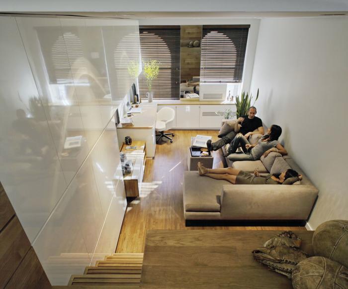 Главное место в гостиной комнате отводится мягкой компактной мебели.