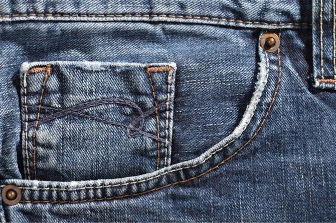 Зачем на карманах джинсов маленькие металлические заклёпки