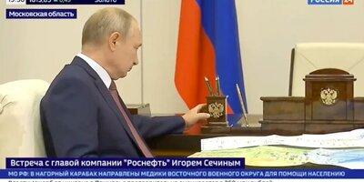 Путин на встрече с Сечиным погладил символ власти