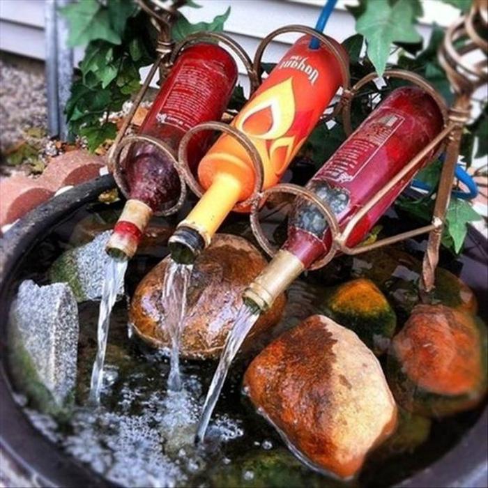 Самодельный садовый фонтан.