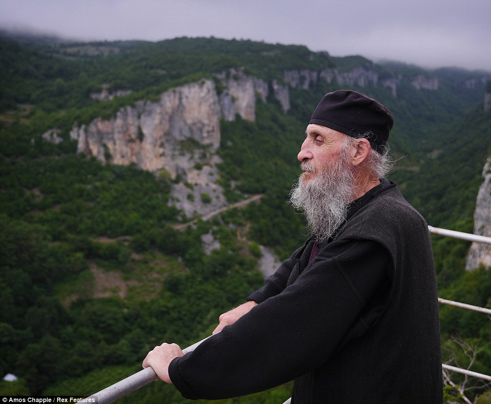 Dedicated: Maxime stands by the church on top of the Katskhi Pillar looking at the beautiful view. He has lived a life of virtual solitude on top of a pillar high above his Georgian monastry for 20 years