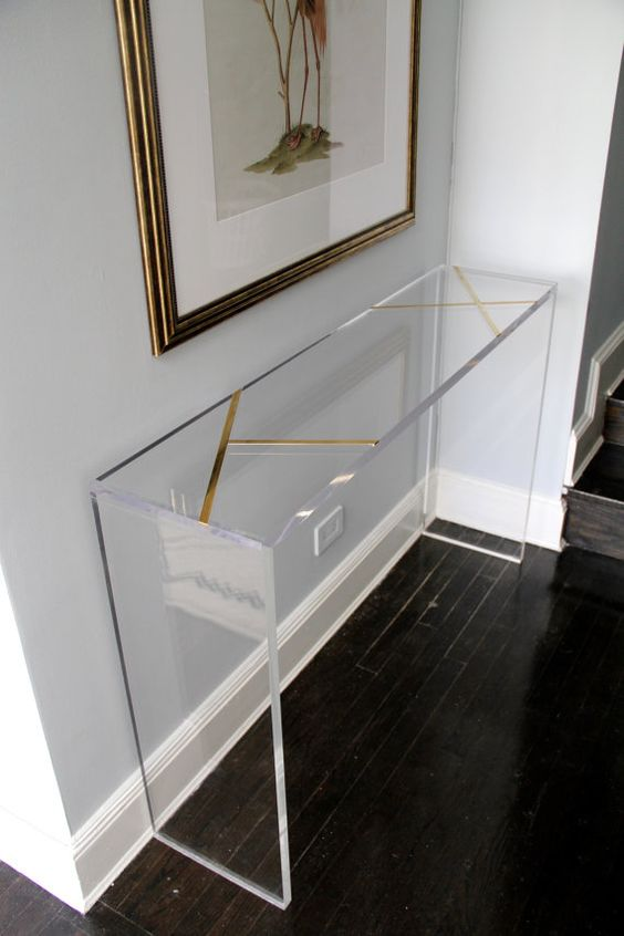 16 brass inlay lucite console will look very lightweight in an entryway