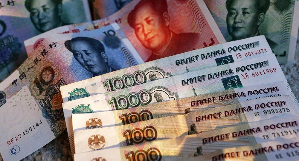 Красный свет «зеленому». Юань и рубль объединились против доллара