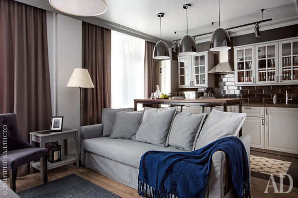 "Вид на зону гостиной и кухню. Диван IKEA. Торшер сделан на заказ, ""Бонжур Абажур""."