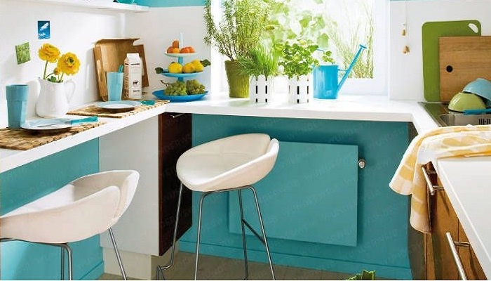 П-образная столешница в кухне позволила организовать обеденную зону и создать большую рабочую поверхность.