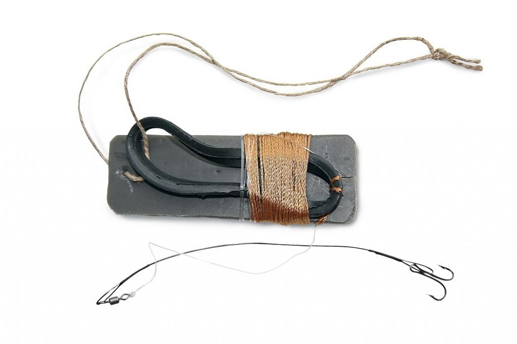 Такой амортизатор не мешает сходу шнура с жерлицы.