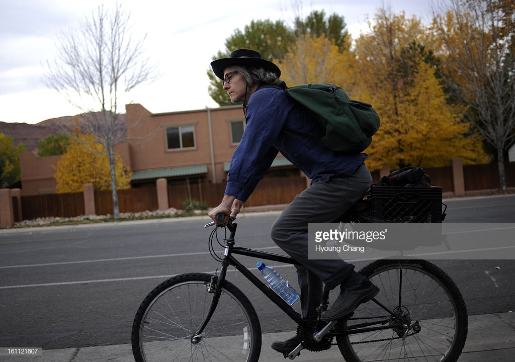 Daniel Suelo cruises around Moab with his bicycle. Suelo had a CU Masters degree in accounting and a promising career in 2000 when he began what he calls 'an experiment.' Since that time nine years ago, he has lived without money. He eats from dumpsters a : News Photo