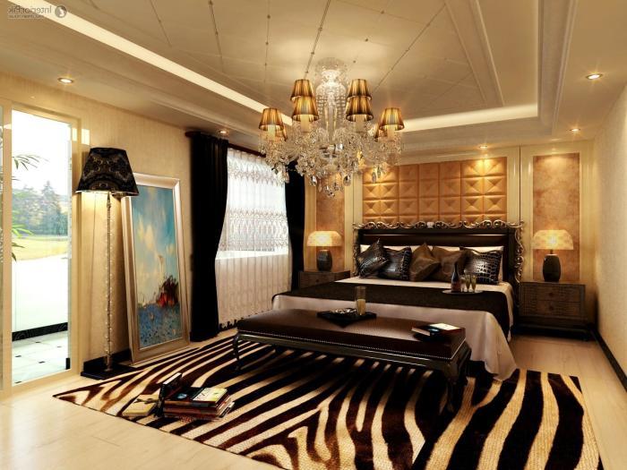 Роскошная спальня, выполненная в золотых тонах и оттенках.