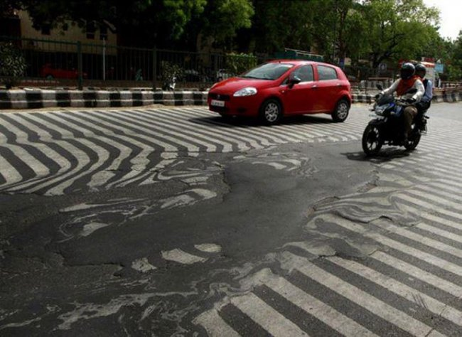 Таяние асфальта в Индии (фото дня)