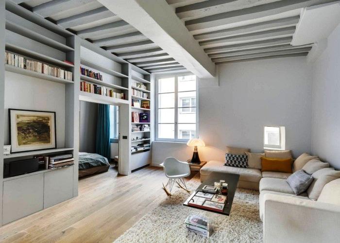 Стенка из гипсокартона поможет в зонировании комнаты.