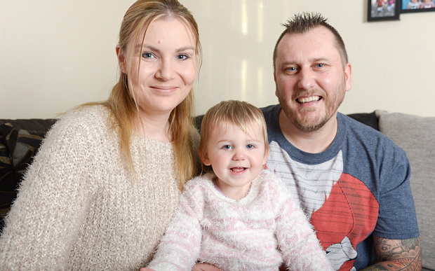 Bella Moore-Williams, pictured at home in Clacton-on-Sea, Essex, with parents Francesca & Lee.y.