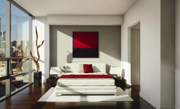 белый ковёр на тёмном полу в интерьере современной спальни