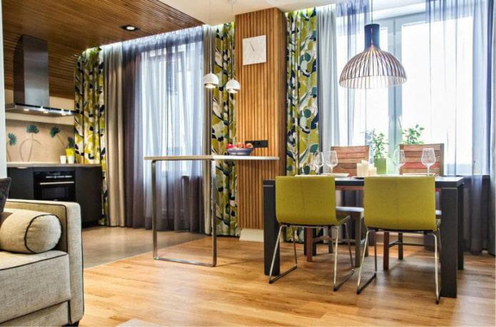 двойные зеленые шторы в гостиной