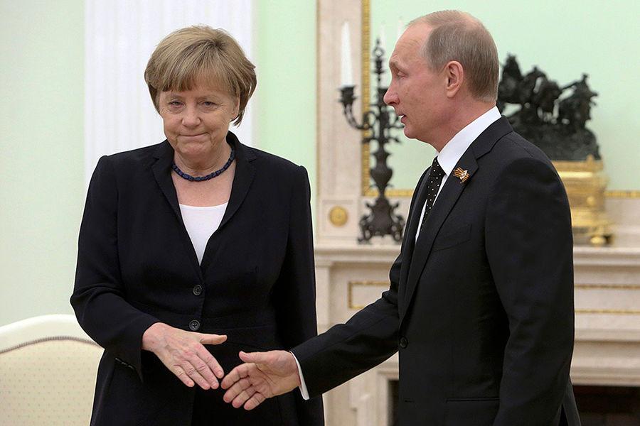 Фоторепортаж: Владимир Путин встретился с Ангелой Меркель в Москве